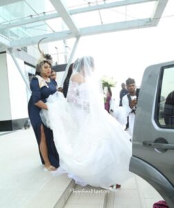 Nabila ushered in to the wedding venue by her maid-of -honour -dailyfamily.ng