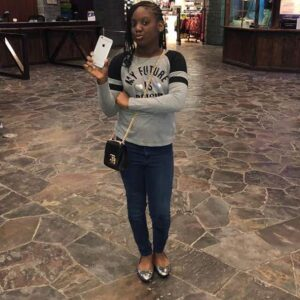 Isabella Idibia posed for a portrait in a mall