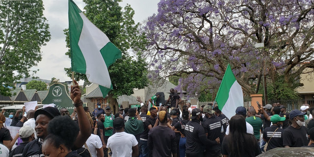 Nigerian protesting the wrongful killing of Stanley Igwe